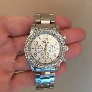 silver toned metal watch